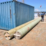 065   The new palm leaf matting sails arrive in 40-foot tubes
