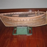 147   Model of the Jewel of Muscat under construction. Mast now being stepped, rigging commenced and sails underway. By Den Smith