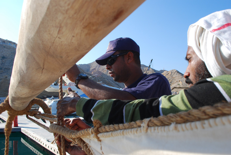 Yahya al Faraji helps attach a sail