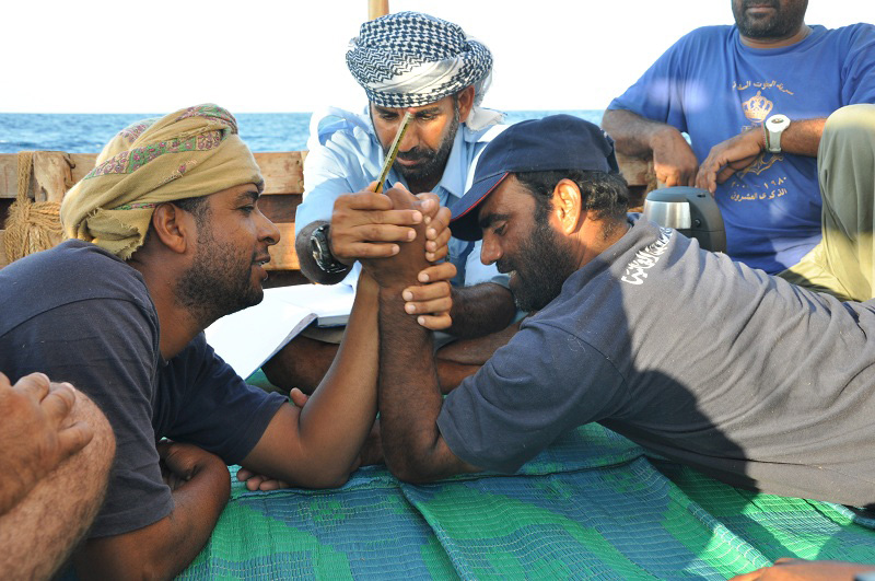 Arm wrestling between Yahya and Ahmed
