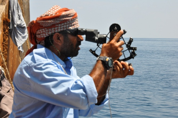 Captain Saleh Al Jabri uses the sextant to take a reading from the sun