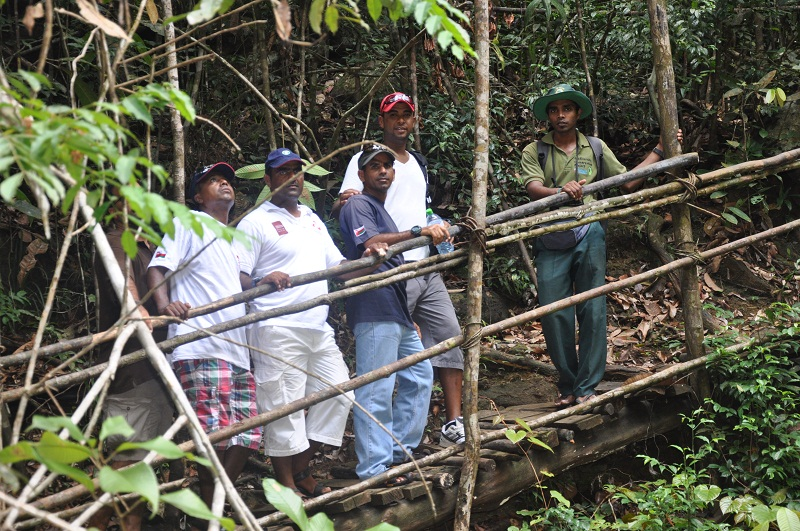Khamis Al Hamdani, Ahmed Al Balushi, Captain Saleh Al Jabri, Yayha Al Faraji and Vishan pause during their walk through the rainforest