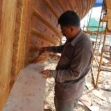 079   Head shipwright shaping the cheek piece (1)