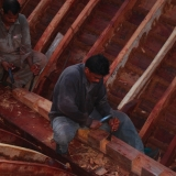 097   Shaping the sister keelson: additional timbers placed alongside the keelson