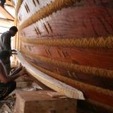 081   Head shipwright shaping the cheek piece (2)