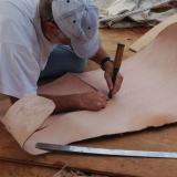 046   Tom Vosmer cuts leather for the quarter rudders