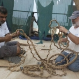 077   Master Rigger Hussain works with Tom Vosmer on the ship's rigging.