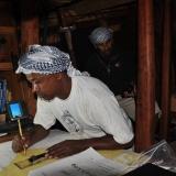 040   1st Mate Khamis Al Hamdani at work on the ship's charts