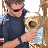 046   Alessandro Ghidoni using a traditional clay water jug