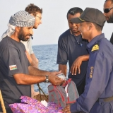 144   Captain Saleh exchanges gifts with an Indian naval officer