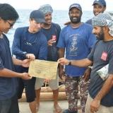 154   Singaporean Jeff Khoo receives a certificate from Captain Saleh.