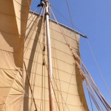 044   Eric Staples examines the top of the main mast for wear
