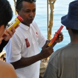080   First Mate Khamis Al Hamdani shows the crew how to use emergency flares