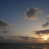 071   Sunrise over calmer seas