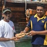 061   Captain Saleh presents an engraved block to Lt. Amila Abeywickrama of the Sri Lankan Navy