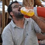 043   Adam Al Balushi  enjoys cold mango juice delivered by the Sri Lankan Navy