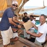 046   Geoffrey Dobbs receives a crew member's certificate from Captain Saleh