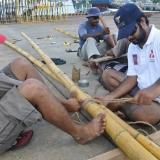081   Sajid Valappil and Ayaz Al Zadjali bind bamboo poles to make a new lower yard
