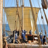 004   Enthusiastic crew members raise the mainsail to begin the voyage to Sri Lanka