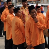 003   Malaysian drummer boys watch from the port