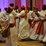 112   The Omani dance troupe arrives on the scene