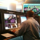 036   A controller at Singapore's Port Control Centre helps guide Jewel in to harbour