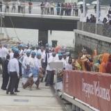 066   The dancers lead the crew ashore