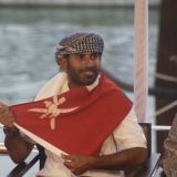 073   A beaming Capt Saleh listens to the speech
