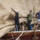 087   Working on the Jewel's palm leaf mat sails