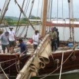 093   Working on the Jewel's palm leaf mat sails