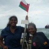 131   Capt. Fernando's daughter Rashmi & Navy Commodore's daughter Kavindya wave the Omani flag that Saleh threw across whilst they we