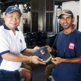 153   Captain Martin Lim exchanges gifts of appriciation with  Captain Saleh Al Jabri