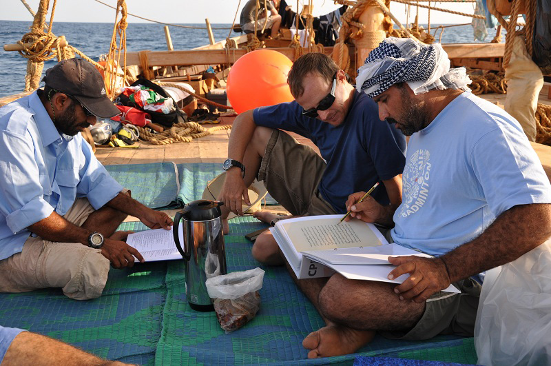 Captain Saleh, Eric Staples and Adam Al Baluchi study 15th century Arab navigational texts