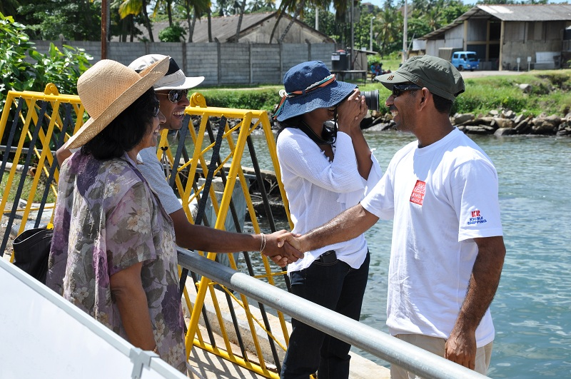 Captain Saleh greets three of the four thousand visitors who have come to learn about the Jewel of Muscat since she arrived in Galle