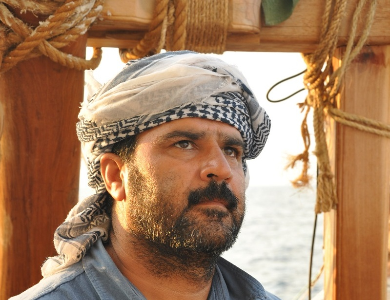 Adam Al Baluchi at the helm