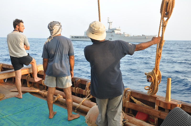 Crew watching the arrival of an Indian naval vessel