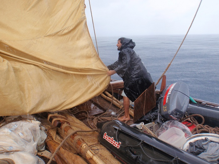 Adam Al Balushi helps lower the mizzen during today's squall (AA Photo)